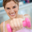 Gym woman with free-weights — Stock Photo #7771351