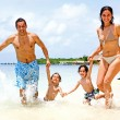 Happy family on vacation — Stock Photo #7771375