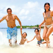 Happy family on vacation - Stock Photo