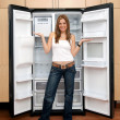 Stock Photo: Womwith empty fridge
