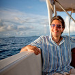 Man in a yacht - Stock Photo