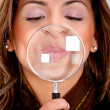 Woman with magnifying glass — Stock Photo #7771511