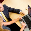 Business couple on a laptop — Stock Photo #7771568