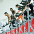 Spinning at the gym - Stock Photo
