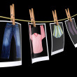 Clothes pin holding photographs - Stock Photo