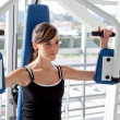 Woman at the gym exercising — Stock Photo #7771586