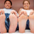 Couple barefoot on bed — Stock Photo #7771636