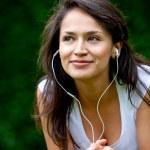 Girl with earphones outdoors — Stock Photo
