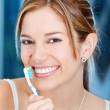 Womholding toothbrush — Stock Photo #7771672
