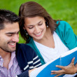 Couple of students outdoors — Stock Photo #7771690