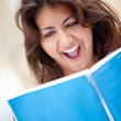 Surprised female student - Stock Photo
