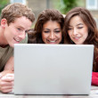 On a laptop outdoors — Stock Photo