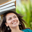 Woman balancing books — Stock Photo