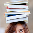 Stock Photo: Woman balancing books