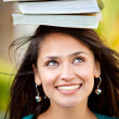 Woman balancing books — Stock Photo #7771716
