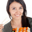 Woman eating sushi - Stock Photo