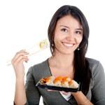 Woman eating sushi — Stock Photo