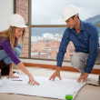Architects at a construction site - Stock Photo