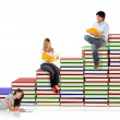 Students with a pile of books — Stock Photo