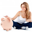 Woman with a piggybank — Stock Photo #7771771