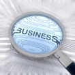 Business with a magnifying glass — Stock Photo