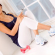Gym woman listening to music - Stock Photo