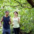 Couple jogging outdoors — Stock Photo
