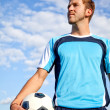 Man with a football — Stock Photo #7771924