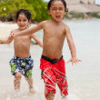 Kids at the beach — Stockfoto