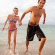Beach couple running — Stock Photo #7771976