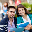 Happy students outdoors — Stock Photo