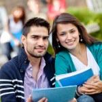 Happy students outdoors — Stock Photo
