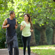 Stock Photo: Couple jogging outdoors
