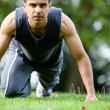 Man exercising outdoors - Stock Photo