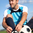 Football player getting ready - Stock Photo