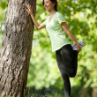 Woman stretching outdoors — Stock Photo