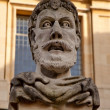 Face carved in stone — Stockfoto