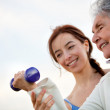 Woman exercising with trainer — Stock Photo