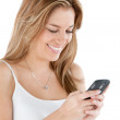 Woman texting on cell — Stock Photo