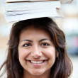 Stock Photo: Student balancing books