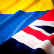 Colombian and British flag - Stock Photo