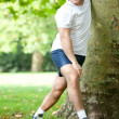 Man stretching outdoors — Stock Photo