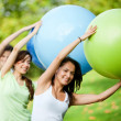Foto de Stock  : Pilates class outdoors