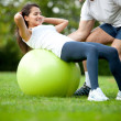 Woman and her sports trainer — Stock Photo #7772312