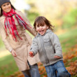 Family in autumn — Stock Photo