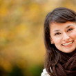 Royalty-Free Stock Photo: Autumn woman smiling