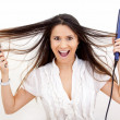 Stock Photo: Womwith hair straightener
