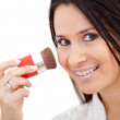 Woman putting make up — Foto Stock