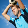 Footballer doing throw in — Stock Photo #7772525