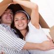 Happy couple moving — Stock Photo
